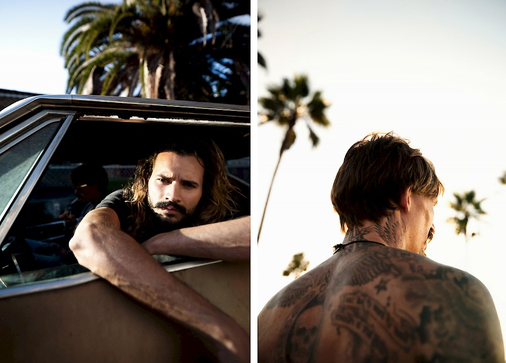 two pictures of guys in evening, the one, tattooed, is walking towards the sunset with palm trees in the background, the other one with longer hair is looking out of the window of his Impala SS