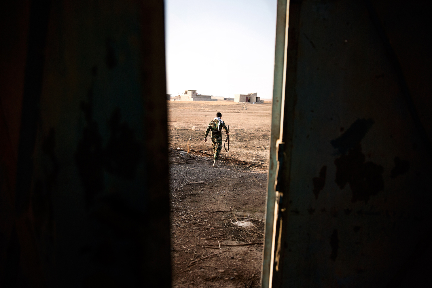 Peshmerga soldier walking in Kurdistan, Iraq.