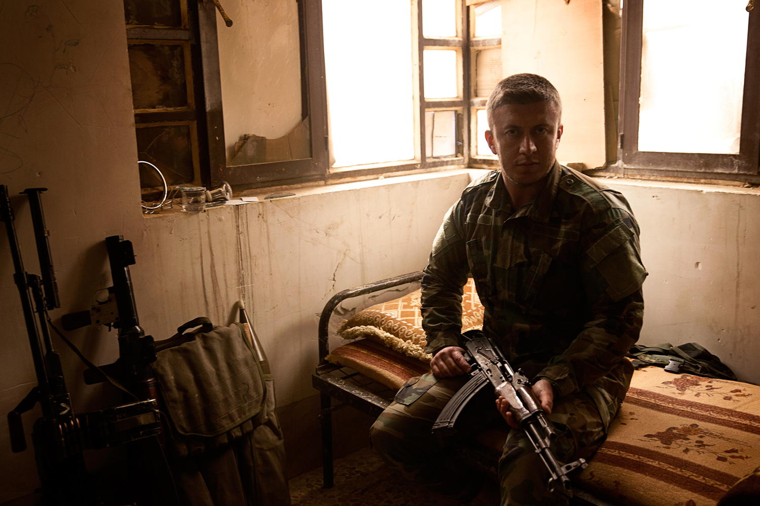 A kurdish Peshmerga Soldier on his bed