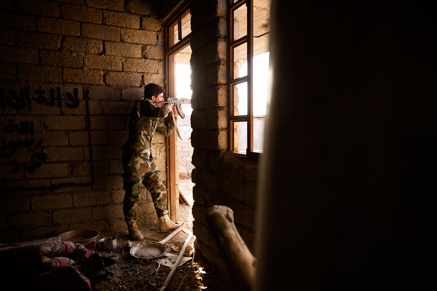 A Peshmerga fighter with his weapon